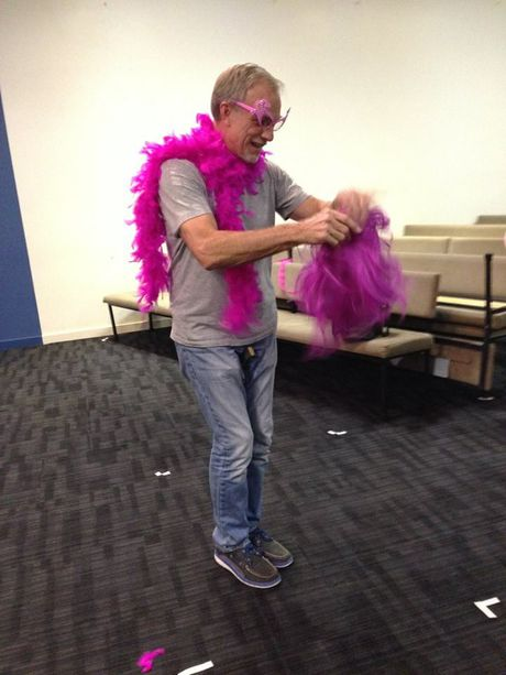 Pastor Joel Baker gets into the spirit of the Pink Pong a Thon challenge.