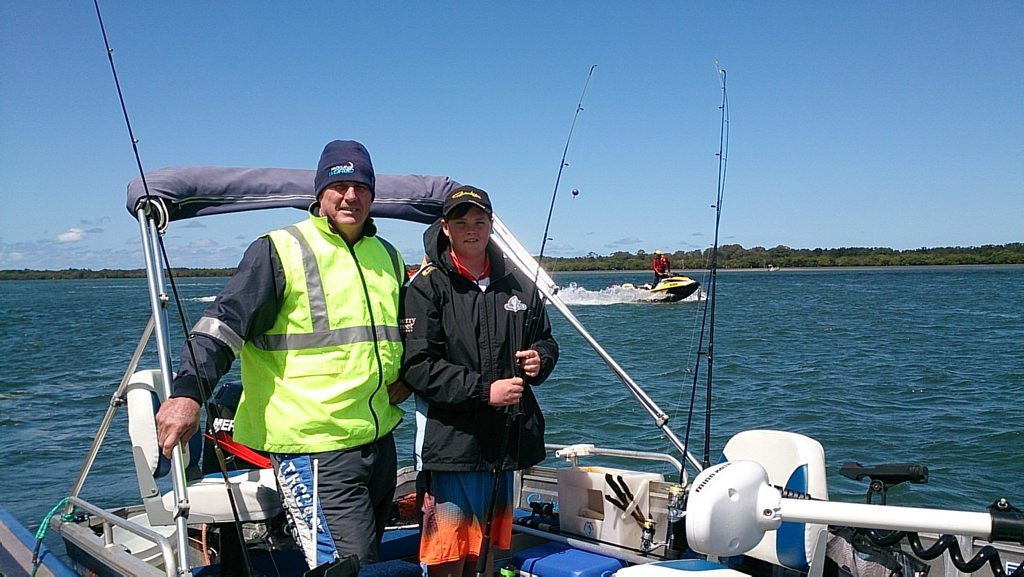 Dale and Jack Miles at the Ballina jetty after catching a 48-centimetre flathead at Pimlico. Photo Ross Kendall / Northern Star