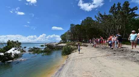 A large sink hole has swallowed a large chunk of the camping area on Inskip Point, taking with it a caravan, camper trailer and one vehicle. Photo: Che Chapman / Sunshine Coast Daily