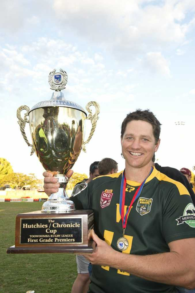 CELEBRATION: Aaron Scheid shows off the Hutchies-Chronicle Cup. Photo Nev Madsen / The Chronicle