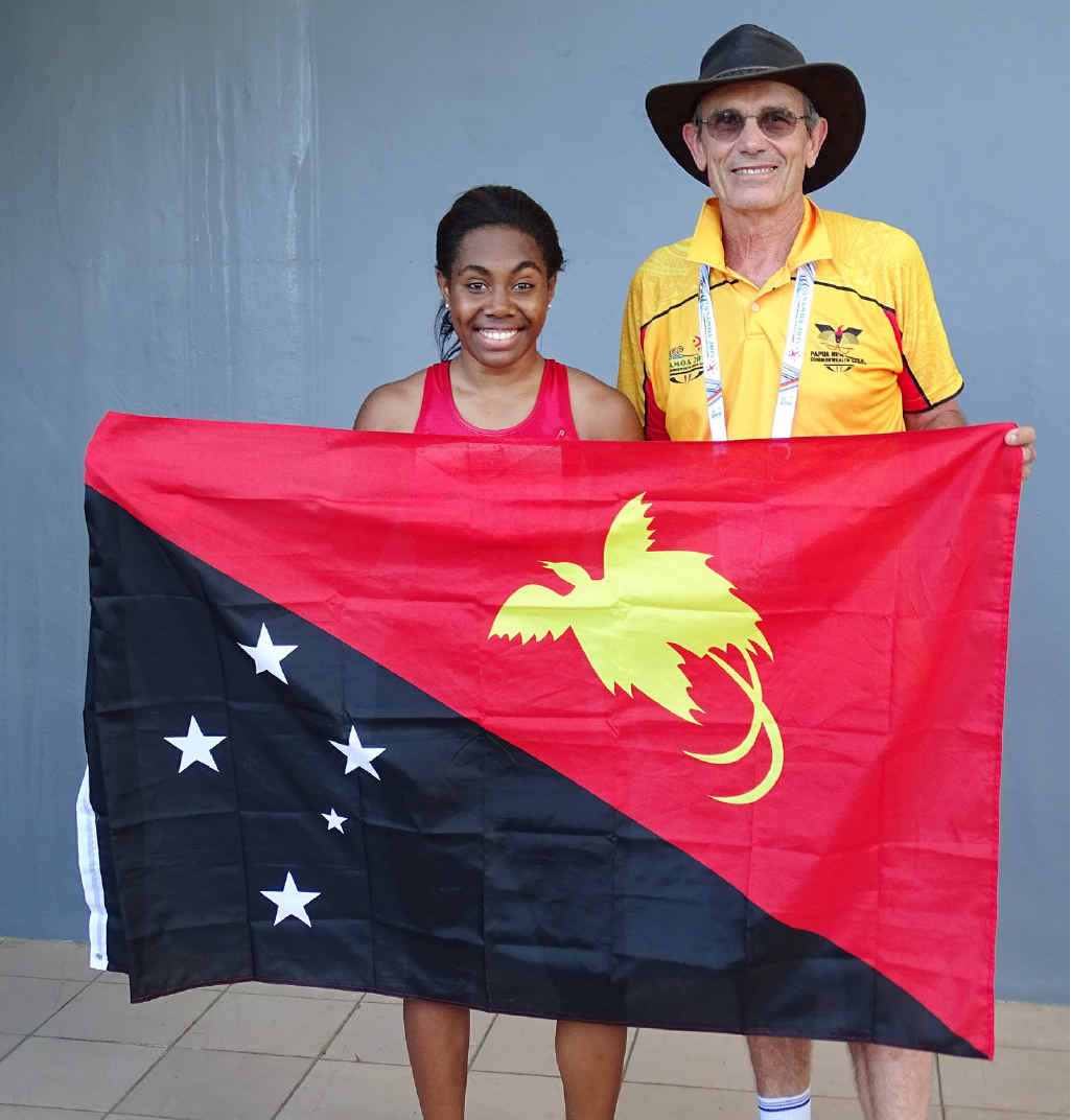 FLAGGING SUCCESS: Ipswich sprinter Miriam Peni, representing PNG, with her coach Vic Pascoe at the Commonwealth Youth Games.