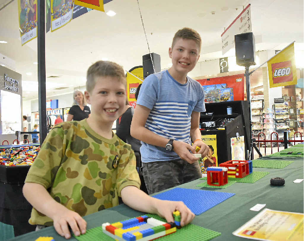 LEGO MASTERS: Edward and Richard Griffiths working on their creations.