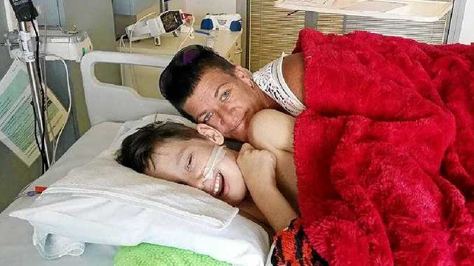 BY HIS SIDE: Lachlan and his mother Tanya spend most of their days at the Lady Cilento Children's Hospital in Brisbane while Lachlan recovers.