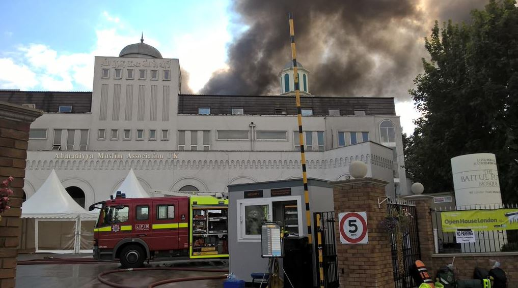 Two boys have been arrested after the bottom floor of Britain's largest mosque was engulfed in flames