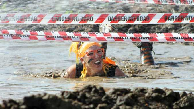 A MUDDY GOOD TIME: De'alle Ferguson taking part in the 2014 Emerald Mud Run.