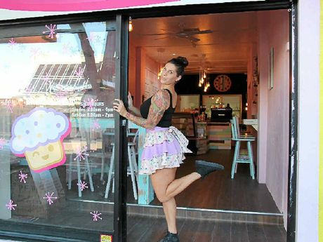 CUPCAKES ROCK: Stormie Duffy at her 1950s-style cupcake shop that opened this month in Caloundra.