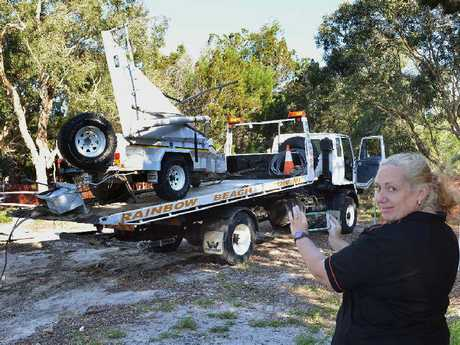 Carolyn Elder from Rainbow Beach Towing films the recovery.