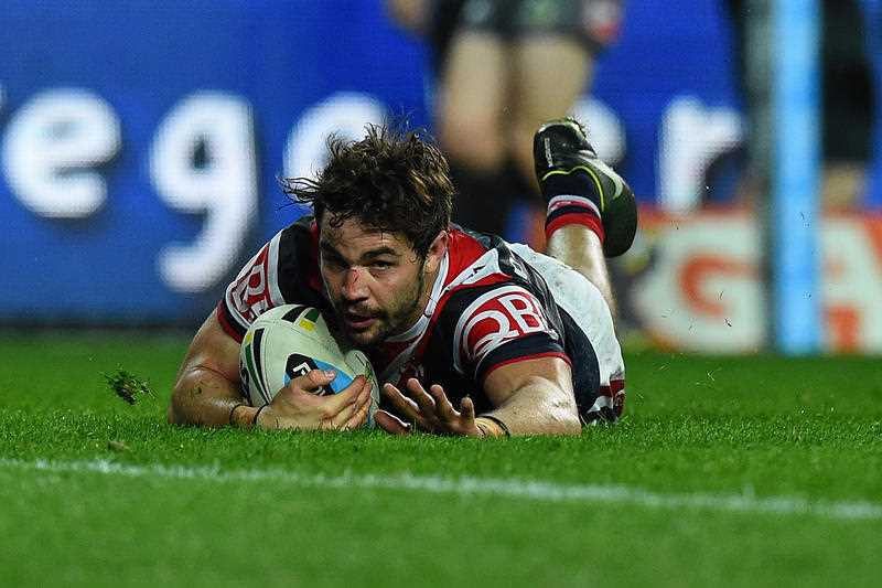 Aidan Guerra of the Roosters scores a try during the Round 26 NRL match between the Sydney Roosters and the South Sydney Rabbitohs at Allianz Stadium, Sydney, Friday, Sept. 4, 2015.