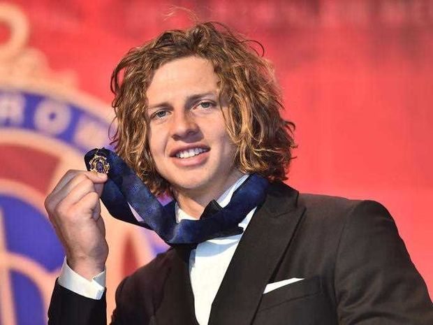 Fremantle Dockers player Nat Fyfe reacts after winning the Brownlow Medal at Crown in Melbourne, Monday, Sept. 29, 2015. The Brownlow medal is awarded to the best and fairest AFL player in the home and away season.