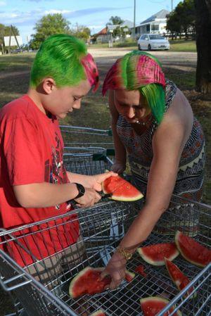 Jack and Bec Wilson enjoy some watermelon.