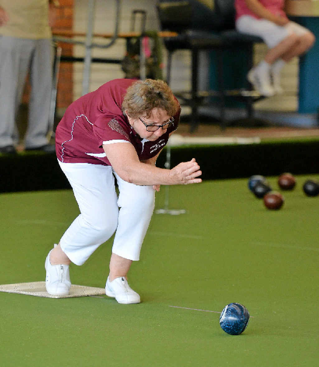 Pauline Turchet rolls one down the green at Mackay City Bowls Club.