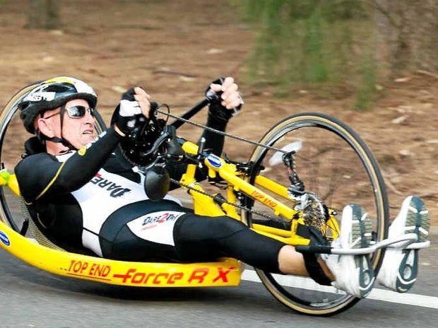 DIGGING IN: Mark Urquhart in his para triathlon hand cycle.