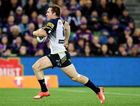 Cowboys five-eight Michael Morgan scores a field try during the NRL 2nd preliminary finals, between the Melbourne Storm and the North Queensland Cowboys, played at AAMI Park in Melbourne, Saturday, Sept. 26, 2015.