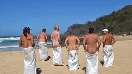 **WARNING: NUDITY** Nudist day at Alexandra Beach. Competitors enjoy the sack race. Photo: Warren Lynam / Sunshine Coast Daily