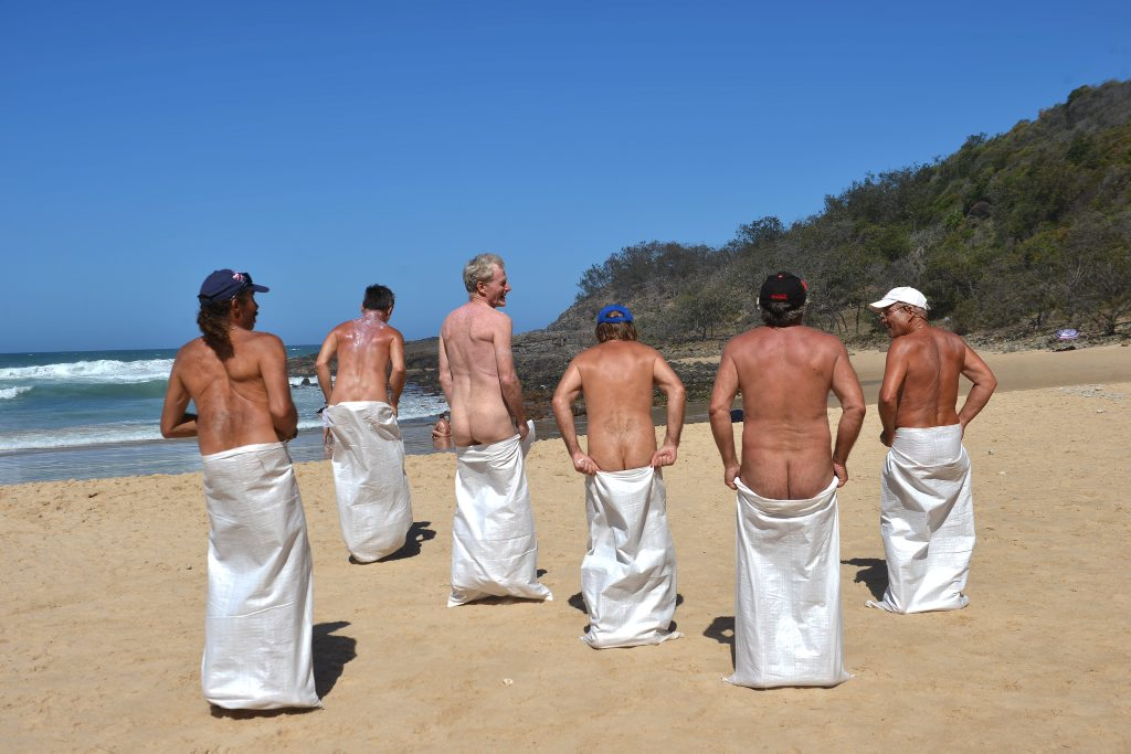 **WARNING: NUDITY** Nudist day at Alexandra Beach. Competitors enjoy the sack race. Photo: Warren Lynam / Sunshine Coast Daily