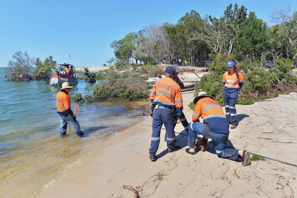 Inskip Point near Rainbow Beach. Recovery attempt for the caravan and 4 wheel drive that were swallowed up by the sinkhole/underwater landslide. Claytons Towing attempted the salvage operation. Claytons workers make up a block and tackle to get more leverage off the tow line. Photo Greg Miller / Gympie Times