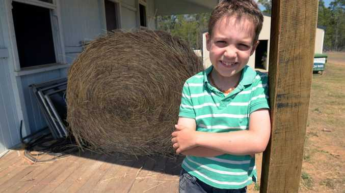 BALED UP: Wal and Michelle Verdel's grandson Ari Hollands hopes that someone can help transport 150 bales of hay to drought stricken farmers in Longreach. Photo: Max Fleet / NewsMail