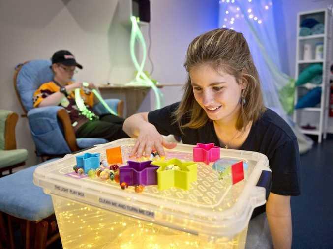 Jessie-Leigh Rahder explores sensations in the Snoezelen Room at ASSERT Services.