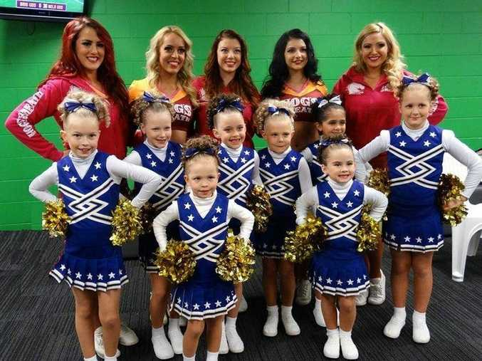 HELPING OUT: Brisbane Broncos cheer squad members are on their way to the NRL Grand Final with the help of Toowoomba City Cheerleaders and members.