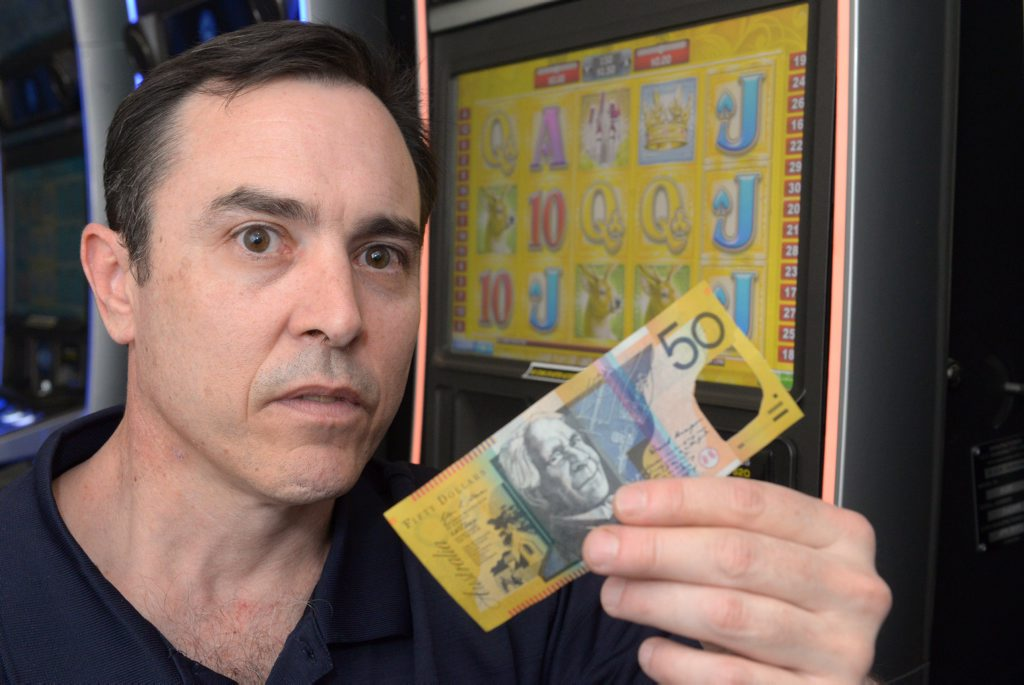 TAKE NOTE: Railway Hotel owner Steve Hooper is finding $50 notes with the holographic windows cut out in pokie machines. Photo: Max Fleet / NewsMail