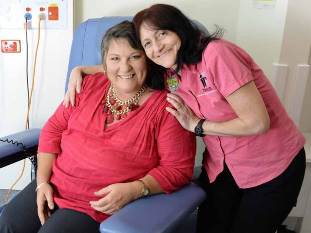 BIG SUPPORT: McGrath Foundation breast care nurse Karen Miles gives Caroline Leach a comforting hug.