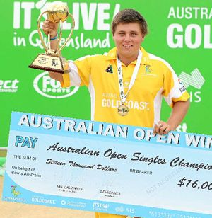 GREAT PLAYER: Aaron Teys with his winner's cheque and trophy after winning the Australian Open on the Gold Coast in June.