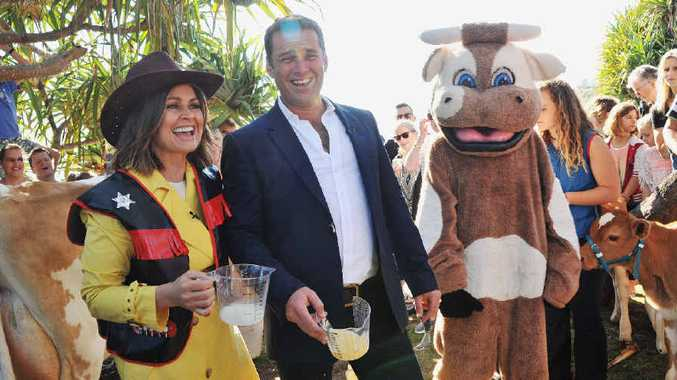 RIGHT MOOVES: Channel Nine Today Show presenters Lisa Wilkinson and Karl Stefanovic have some fun after a milking competition as part of the show broadcast from Moffat Beach.