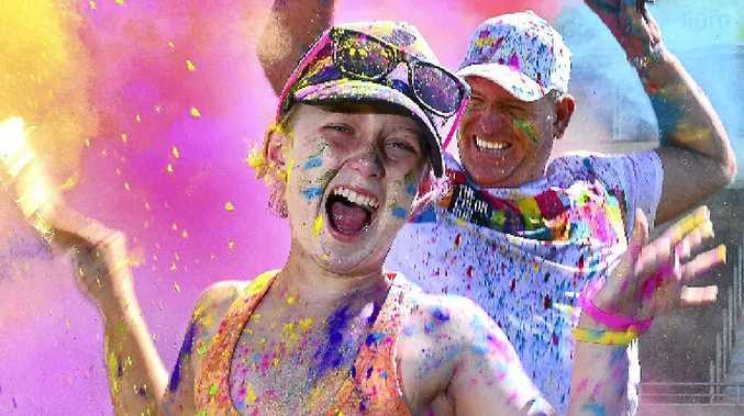 FAMILY FAVOURITE: Jay Jay O'Pray and her dad Cr Jason O'Pray add a dash of colour to the launch of Color Run 2016 at Sunshine Coast Stadium.