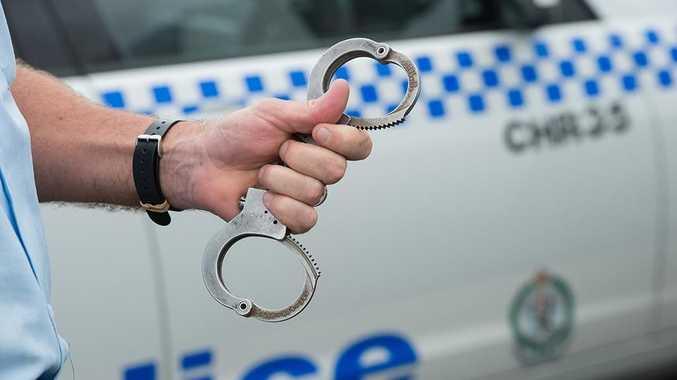 NSW police at coffs harbour boat ramp, arrest , gun, shots, handcuffs  Photo: Trevor Veale / The Coffs Coast Advocate