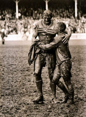 Rivals Norm Provan and Arthur Summons embrace after the 1963 NRL Grand Final