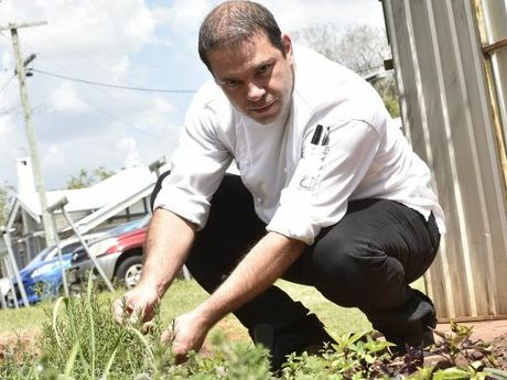 Gips Restaurant Executive chef Bernhard Kohlhuber in the herb garden at the back of the restaurant. Photo Bev Lacey / The Chronicle