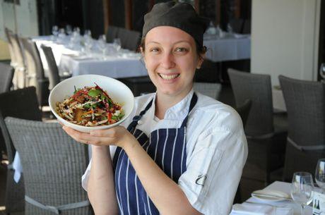 GARDEN FRESH: Encore apprentice chef Shannon Szkurda shows off their crispy pork belly salad from their spring menu. Photo Charlotte Lam / The Chronicle