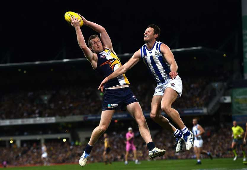 West Coast Eagles player Xavier Ellis (left) marks against the North Melbourne Kangaroos during the second preliminary final of the AFL at Domain Stadium in Perth, Saturday, Sept. 26, 2015. (AAP Image/Julian Smith) NO ARCHIVING, EDITORIAL USE ONLY