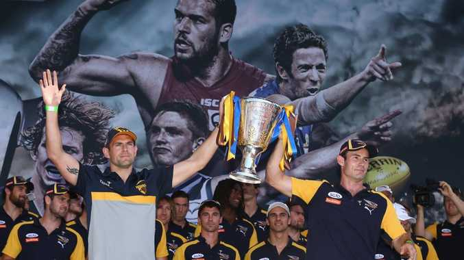 MELBOURNE, AUSTRALIA - OCTOBER 02: Hawks captain Luke Hodge and Eagles captain Shannon Hurn hold aloft the Grand Final Trophy during the 2015 AFL Grand Final parade on October 2, 2015 in Melbourne, Australia. (Photo by Robert Cianflone/Getty Images)