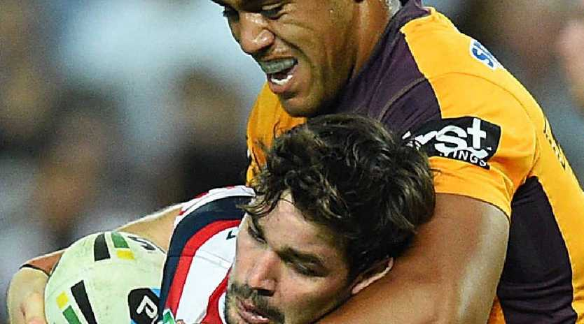COP THAT: Aidan Guerra of the Roosters is hammered by Broncos prop Joe Ofahengaue. Big Joe will come off the bench in tomorrow's NRL grand final.