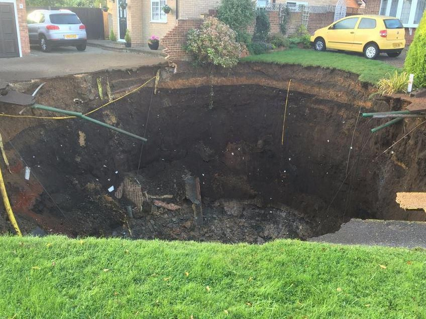 The sinkhole appeared on a residential street overnight Hertfordshire Fire and Rescue Service
