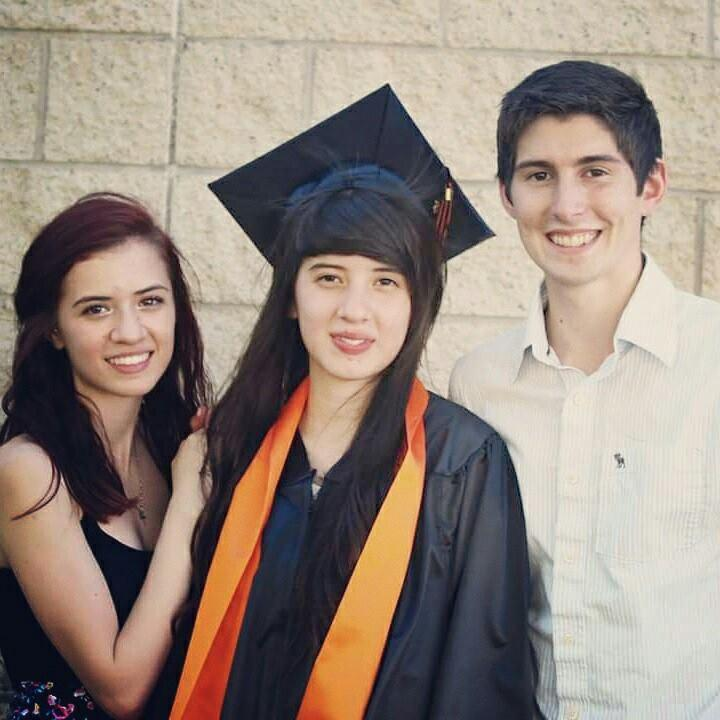 Lucero Alcaraz, middle, with her older sister Maria, left.