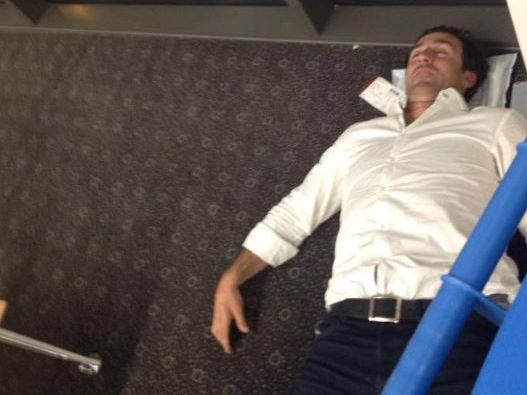 Andrew Johns takes a nap at Wellcamp Airport.