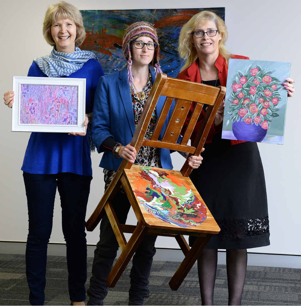 RAISING AWARENESS: Nancye McDonald, Carolyn Perry and artist Robz Davey promote a mental health week art auction.