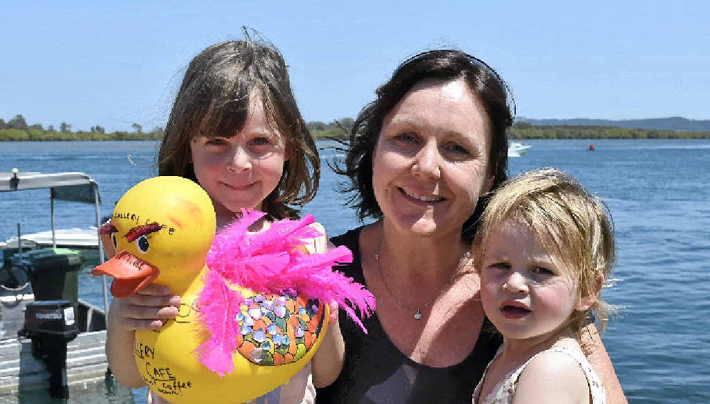 FLYING HIGH: Sofia, Tracey and Stevie Foukkare from the Gallery Cafe are all smiles after taking out the Great Duck Race on the Richmond River yesterday.
