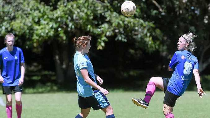 Chloe Dunsmore, right, gets boot to ball for Bangalow.