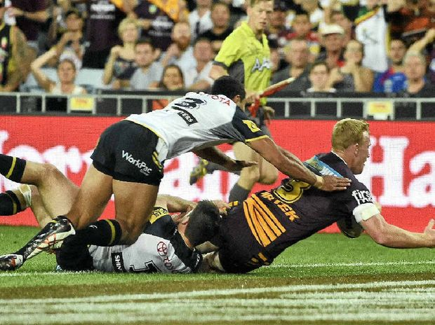 TRY TIME: Bribie Island's Brisbane Broncos centre Jack Reed scores a try during the NRL grand final between the Brisbane Broncos and the North Queensland Cowboys at ANZ Stadium in Sydney last night.