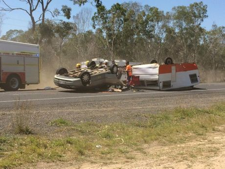 A car and caravan have rolled on the Isis Hwy. Photo Mike Knott / NewsMail