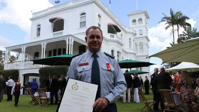 HONOURED: Maryborough paramedic Lyle Oppermann receives a bravery award at Government House for saving two children and their mother from a house fire. photo Contributed / Fraser Coast Chronicle