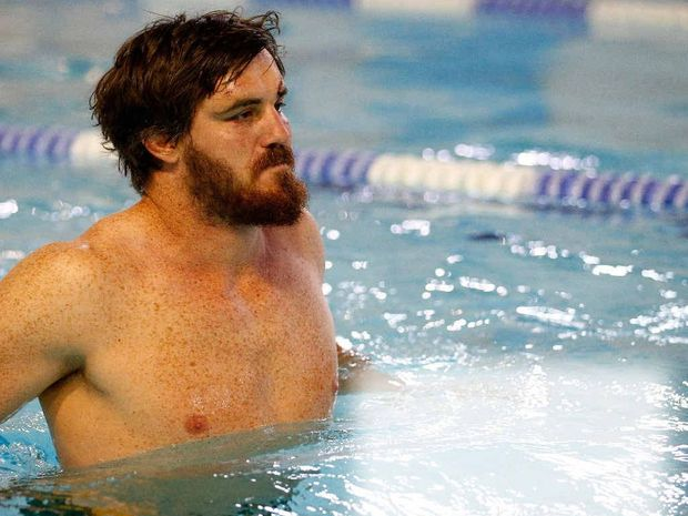 COOLING OFF: Kane Douglas of Australia swims during an Australia team recovery session at the Queen Mother Sports Centre after Australia dumps England from the World Cup. PHOTO: DAN MULLAN