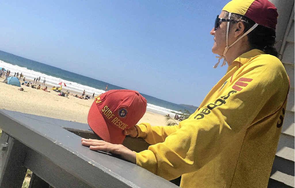 ON WATCH: Rainbow Beach Surf Life Saving Club secretary Melissa Dennien keeps watch over the Rainbow Beach crowd yesterday.