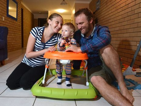 Christina Franklin with her partner Nathan Moon and son Blair,10 months, back at home after being in Brisbane for Christina's cancer treatment.