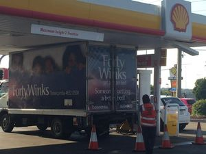Truck gets wedged under Toowoomba petrol station roof
