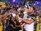 SYDNEY, AUSTRALIA - OCTOBER 04: Gavin Cooper of the Cowboys celebrates with fans after winning the 2015 NRL Grand Final match between the Brisbane Broncos and the North Queensland Cowboys at ANZ Stadium on October 4, 2015 in Sydney, Australia. (Photo by Cameron Spencer/Getty Images)
