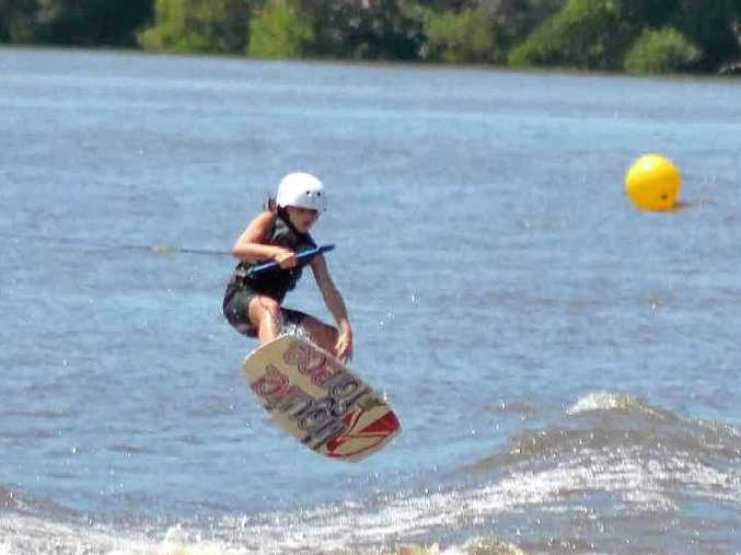 UP AND OVER: World Under-9 waterski champion Mackenzie McCarthy, of the Gold Coast, performs at the Woodburn Riverside Festival on Saturday.